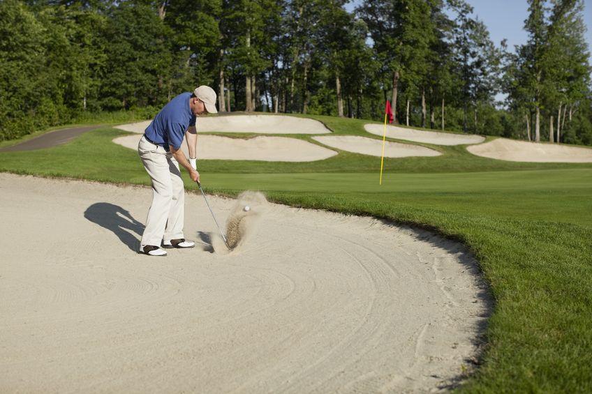 Golfer-in-sandtrap-Adam Grant