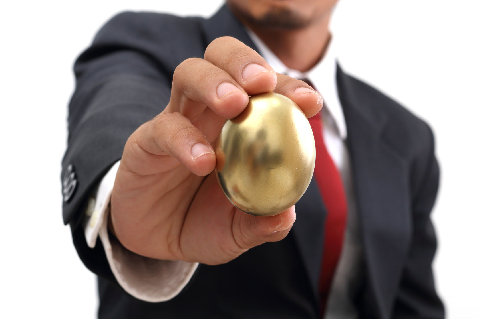 businessman-holding-golden-egg