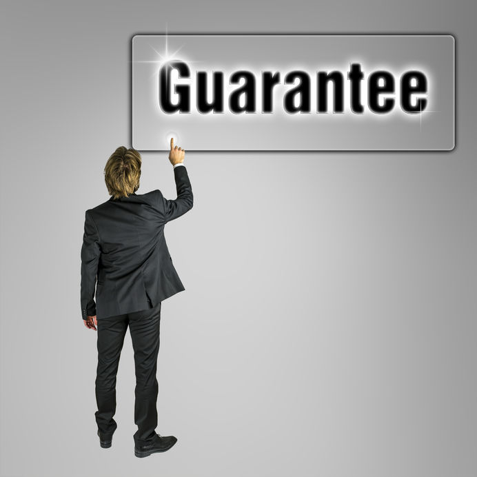 businessman-pointing-word-guarantee