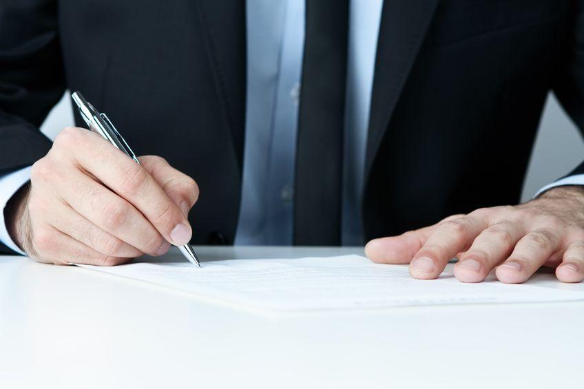 businessman-writing-with-pen-Geoffrey James