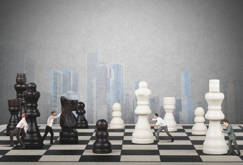 businessmen-moving-chess-pieces