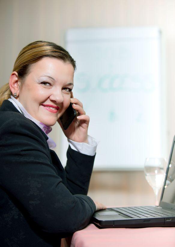 businesswoman-on-phone-Denise Brosseau