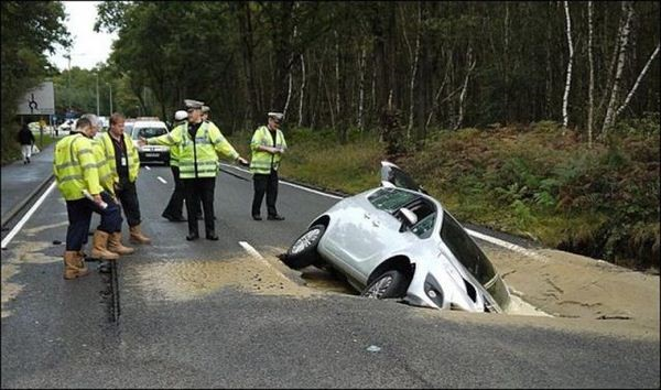 car-in-sink-hole-connie-bentley