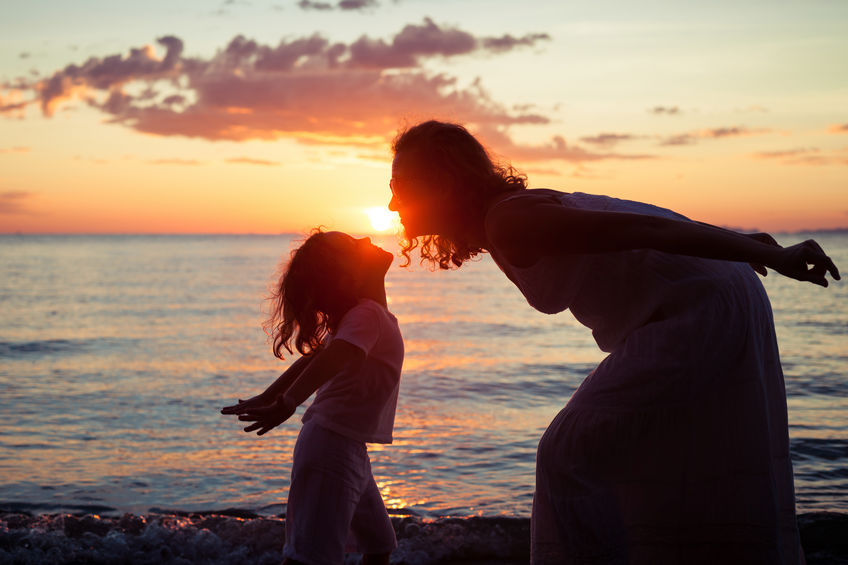 child-mother-sunset