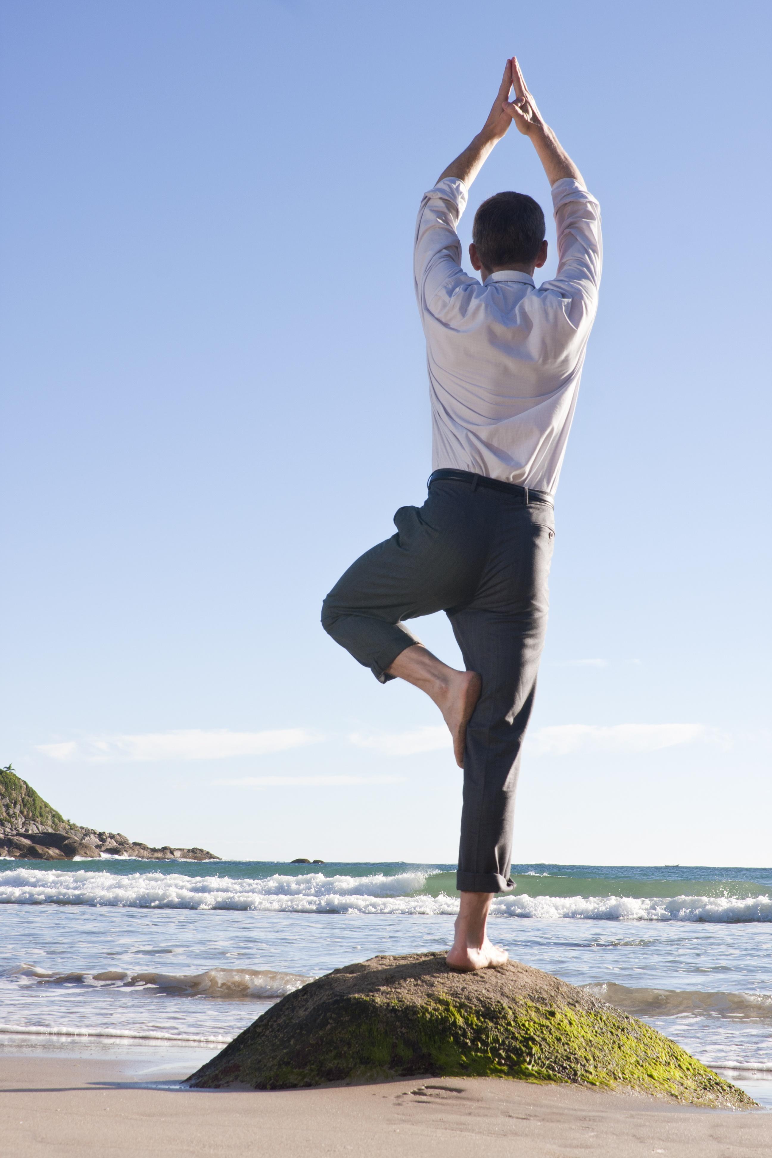 exec-on-rock-doing-yoga