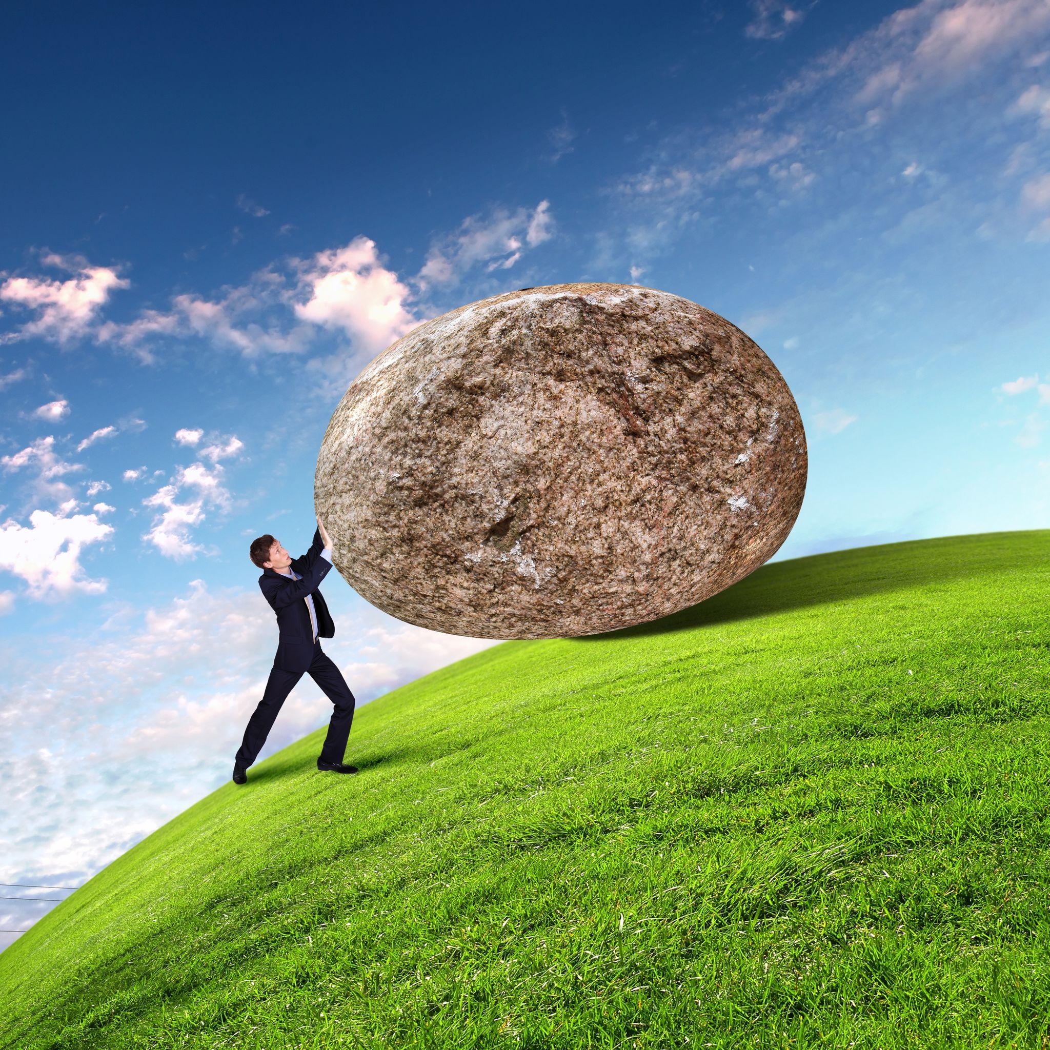executive-pushing-boulder-up-hill