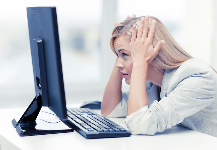 frazzled-businesswoma-looking-at-monitor-Michael-Stallard