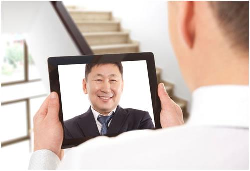 man talking on tablet
