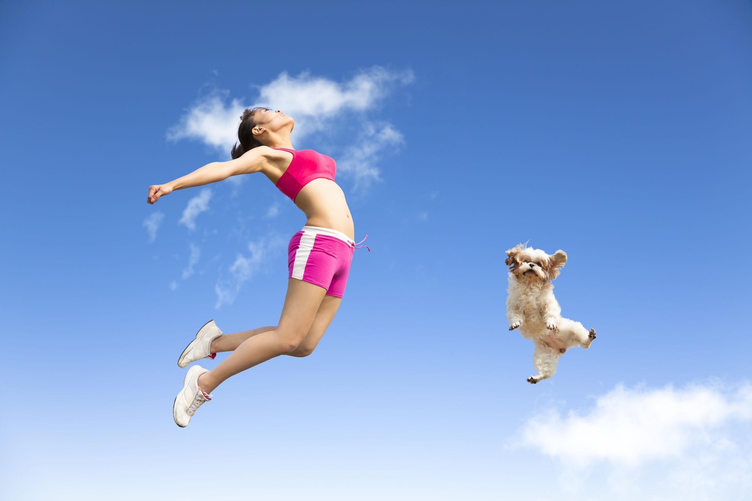 joyful-woman-and-dog