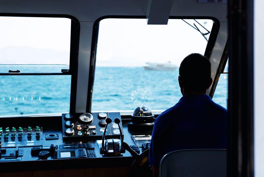 man-steering-ship