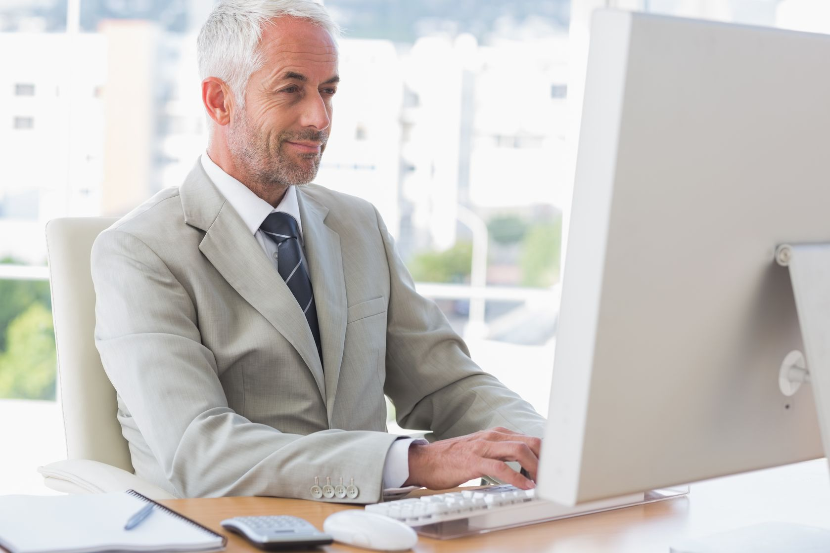 mature-businessman-at-computer