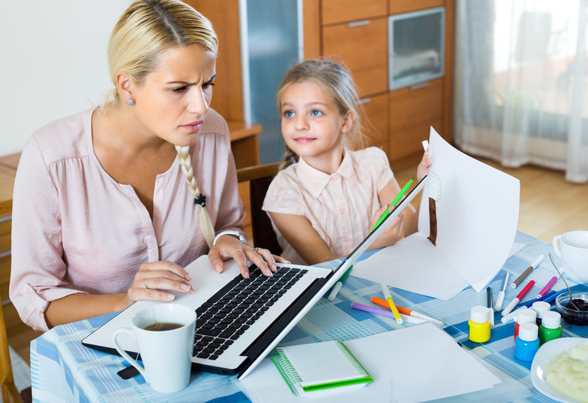mom-distracted-by-child-working
