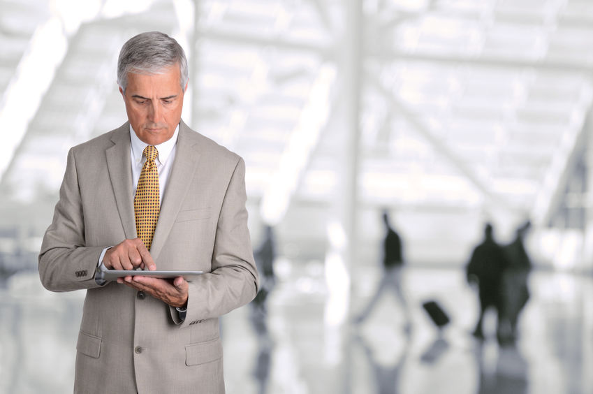 older-businessman-with-tablet