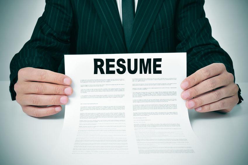 resume-held-by-man-in-suit