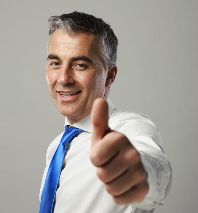 senior-businessman-thumbs-up-Jean Walker