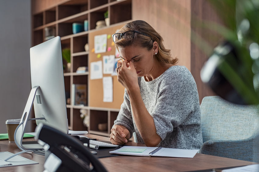 stressed-woman-at-her-desk