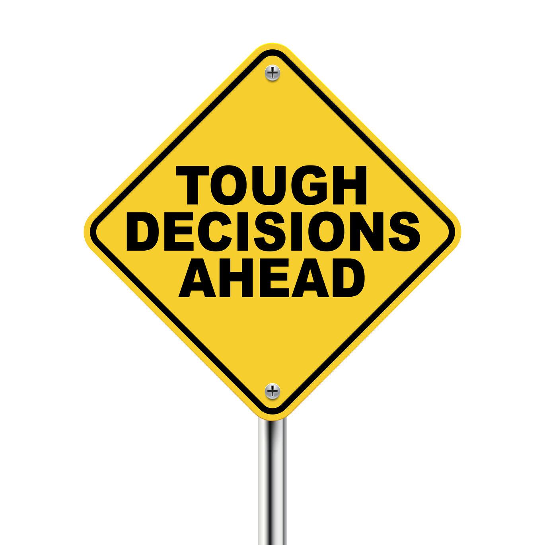tough-decisions-ahead-sign