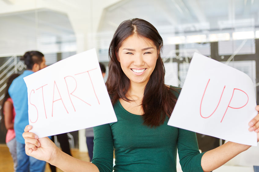 woman-holding-start-up-sign